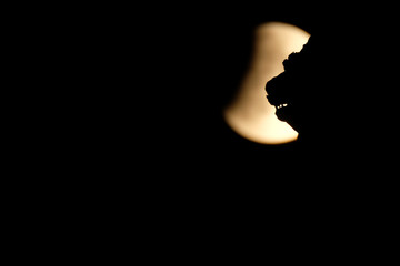 The moon is seen during a partial lunar eclipse over the Winged Lion of Venice at the St. Mark square in Venice