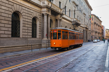 Keuken foto achterwand Milan Old vintage tram in the city centre of the Milan, Lombardia, Italy. Famous tourist destination in South Europe