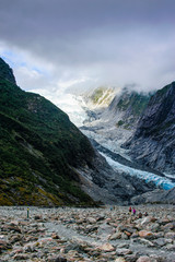 Tourists hiking up to the Franz Josef Glacier, South Island, New Zealand