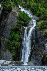 Huge waterfall on the bottom of the Franz Josef Glacier, South Island, New Zealand