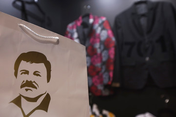 """A paper bag with the image of Mexican drug lord Joaquin """"El Chapo"""" Guzman is seen at a stand of the clothing brand """"El Chapo 701"""" at the Intermoda fair in Guadalajara"""