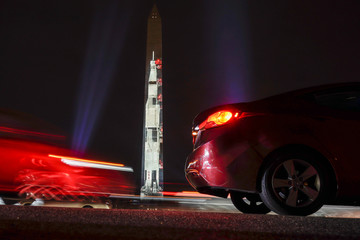 An image of the Saturn V rocket is projected on to the side of the Washington Monument to mark the 50th anniversary of the first lunar mission