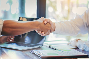 Businessman handshake at business meeting after negotiations with business partners.