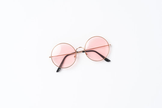 Round sunglasses on white background. Flat lay