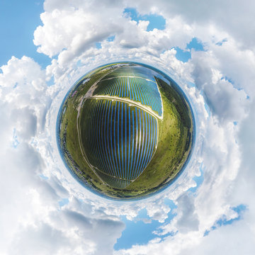 globe panorama. stereographic projection of solar panels farm. 360 degree panorama. little planet