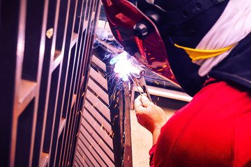 Industrial welder in a steel factory parts, Men who do industrial welding jobs.