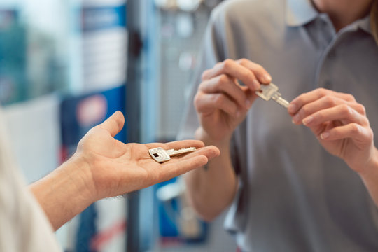 Woman asking locksmith to make a key copy