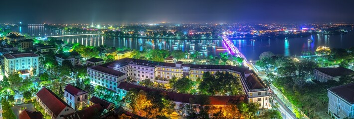 Panoramic city colorful night sparkling view from above in Hue, Vietnam.