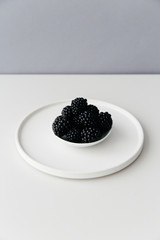 A small bowl of fresh blackberries.