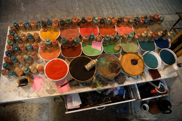 Supplies of coloured sand are seen a souvenir shop owned by Palestinian craftsman Mohammed Al-Awawda in Hebron, in the Israeli-occupied West Bank