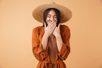Wall Mural - Portrait of a beautiful young woman wearing straw hat
