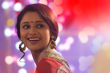 Portrait Of A Woman In Saree With Diwali Lights Bokeh In Background