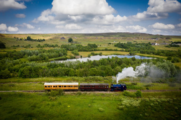 Aluminium Prints Dark grey Aerial view of Landscape with steam train of the heritage railway in Blaenavon driving along Garn Lakes Local Reservce in Wales, UK