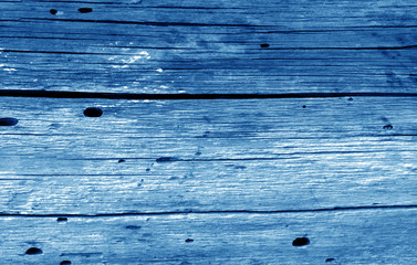 Old grunge wooden fence pattern in navy blue tone.