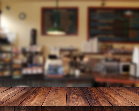 Empty wooden table space platform and blurred cafe background