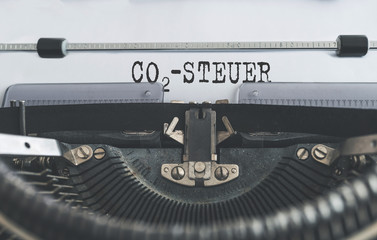 close-up shot of text CO2-STEUER, German for carbon tax, written on old typewriter