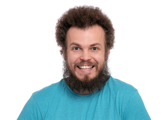Happy Crazy bearded Man with funny Curly Hair, isolated on white background. Smiling and Looking at camera. Emotions and signs concept.