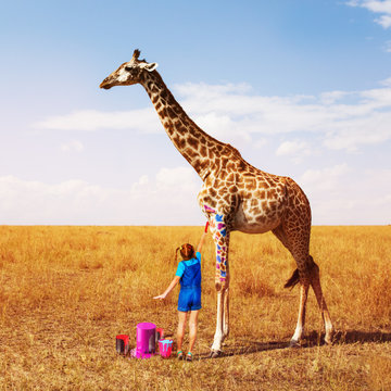 Little girl painting giraffe into many colors