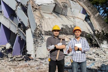 Demolition control supervisor of construction team on demolished building.