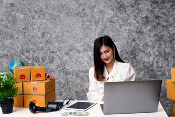 Successful entrepreneur business woman with online sales and Parcel shipping in her home office, prepare parcel box of product for deliver to customer.