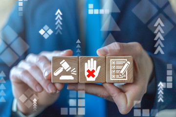 Disclaimer Business Legal Document Terms Conditions concept. Businessman holding wooden cubes with hand cross, gavel and checklist.