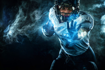 American football sportsman player in helmet on stadium. Sport wallpaper.