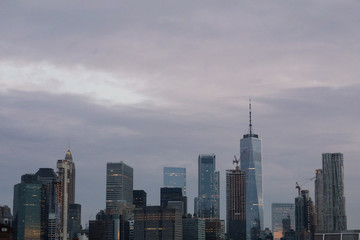 The skyline of lower Manhattan is seen before sunrise in New York