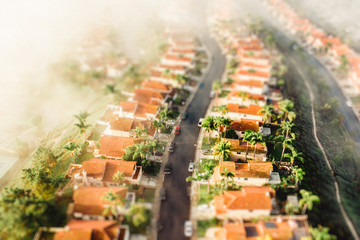 Aerial view similar houses lining residential street