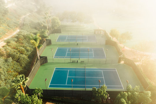 Aerial view of empty tennis courts