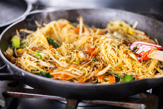 Process of cooking of sweet and crunchy stir fry with beansprouts and noodles in the wok, Macro image
