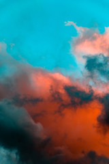 Red light under clouds in blue sky