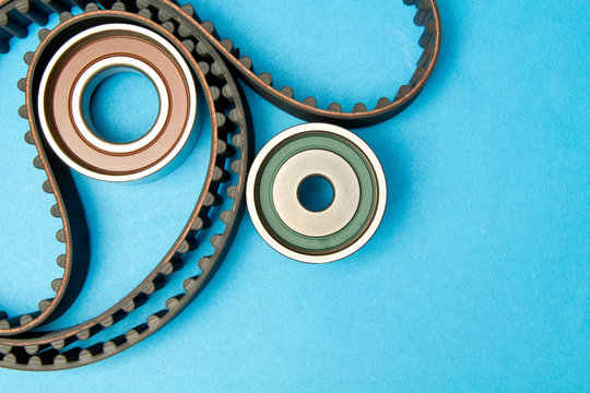 Timing belt with rollers on background .Kit of timing belt for car engine