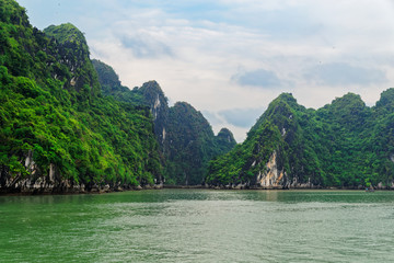 Green mountain islands in Ha Long bay located in Vietnam