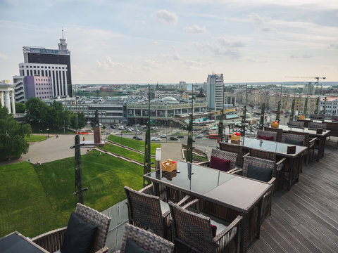 Sky cafe on the roof terrace with view of modern city