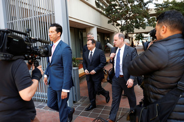 """Former Theranos President and COO Ramesh """"Sunny"""" Balwani leaves after a hearing at a federal court in San Jose"""