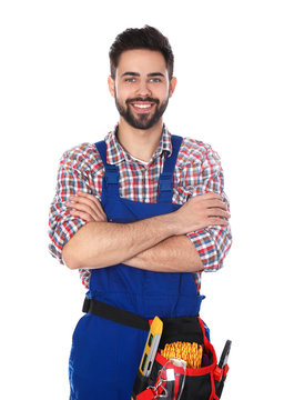 Portrait of construction worker with tool belt on white background
