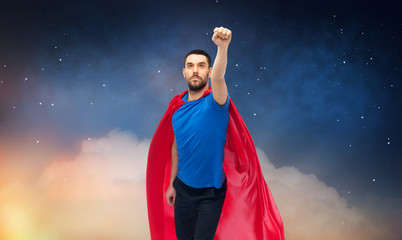 freedom, power, motion and people concept - man in red superhero cape over night sky background