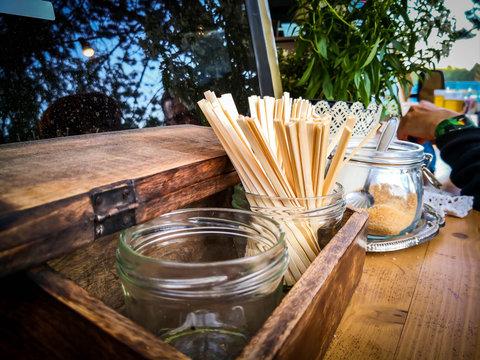 Wooden stir sticks and sugar at coffee shop