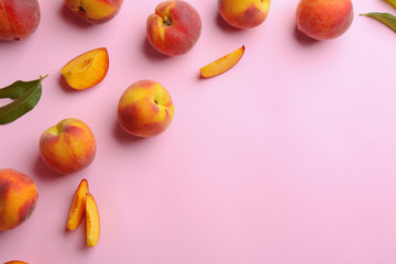 Flat lay composition with fresh peaches on pink background. Space for text