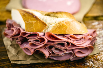 Traditional mortadella sandwich. Salt bread with bologna. Great snack of pork with bread, typical of Brazil.
