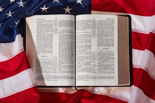 american flag with a bible
