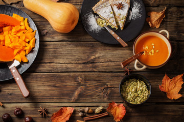 pumpkin dishes on wooden background