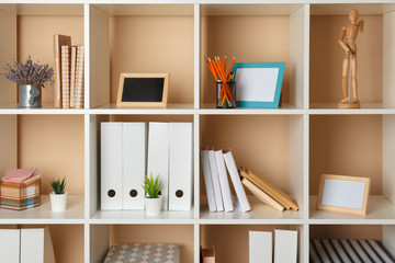 Home office working space. white shelf with accessories