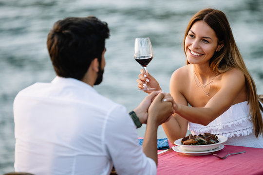 Couple sharing romantic sunset dinner on the beach