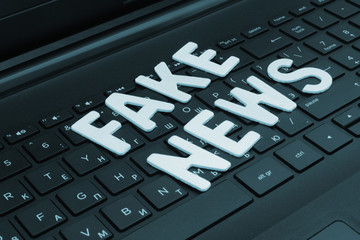 Fake news words on computer keyboard