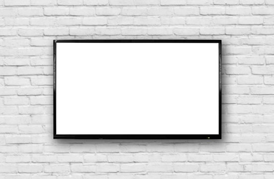 LCD TV with a thin black frame hanging on a white brick wall. Blank white screen. Isolated on white background