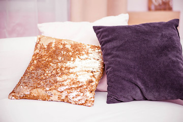 three pillows lie on a bright sofa