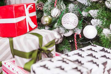 many gifts in festive packaging under the Christmas tree