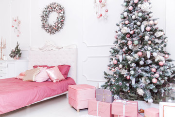 Classic bedroom interior in the New Year's style. Christmas gifts under the tree