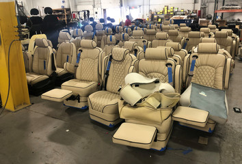 Seats for recreational vehicles wait to be installed on the production line at Midwest Automotive Designs in Bristol, Indiana